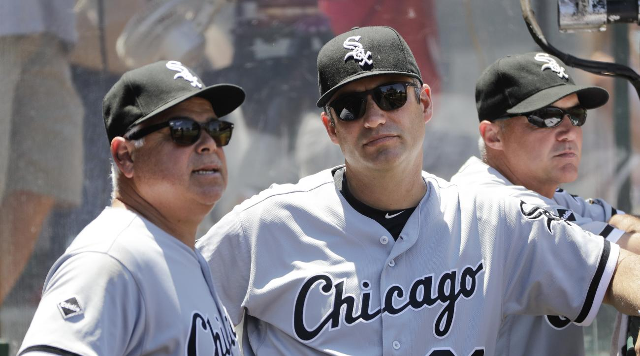 Chicago White Sox manager Robin Ventura, center, listens to bench coach Rick Renteria in the dugout during the fourth inning of a baseball game against the Los Angeles Angels, Sunday, July 17, 2016, in Anaheim, Calif. (AP Photo/Jae C. Hong)