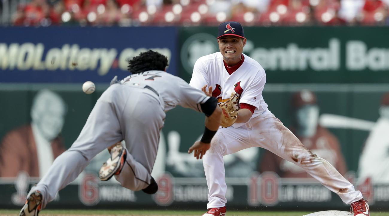 Miami Marlins' Yefri Perez, left, is safe at second for a stolen base as St. Louis Cardinals shortstop Aledmys Diaz covers during the eighth inning of a baseball game Sunday, July 17, 2016, in St. Louis. (AP Photo/Jeff Roberson)