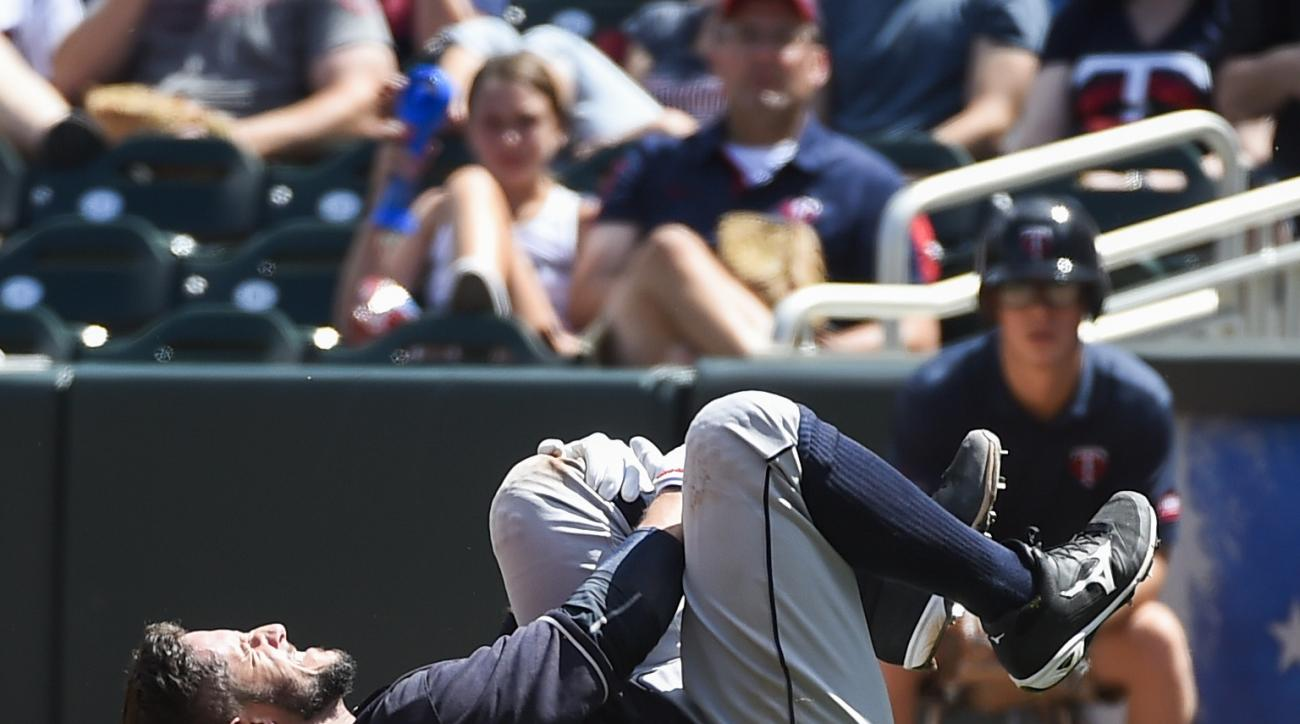 Cleveland Indians Yan Gomes is injured after being tagged out by Minnesota Twins first baseman Kennys Vargas during the fifth inning of a baseball game Sunday, July 17, 2016, in Minneapolis. Gomes had to leave the game. (AP Photo/Craig Lassig)