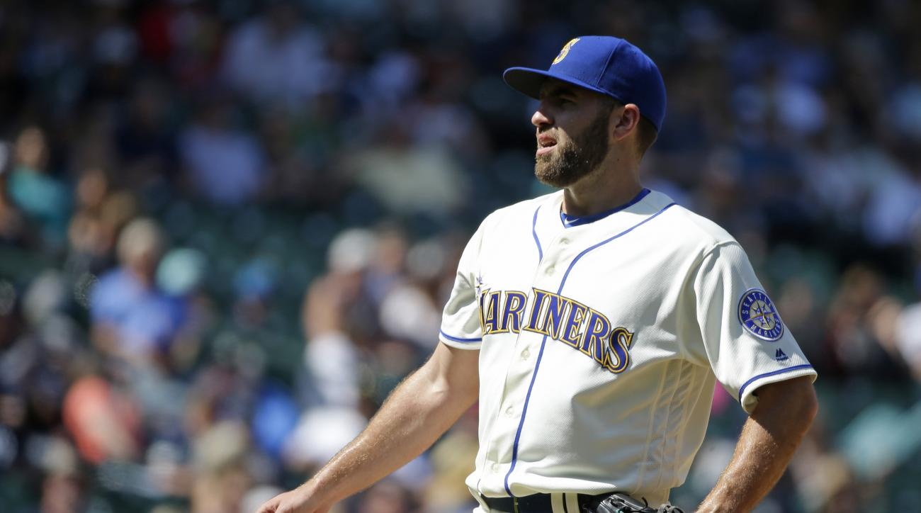 Seattle Mariners pitcher Nathan Karns reacts on the mound after giving up a grand slam to Houston Astros' Carlos Gomezin the seventh inning of a baseball game, Sunday, July 17, 2016, in Seattle. (AP Photo/Ted S. Warren)