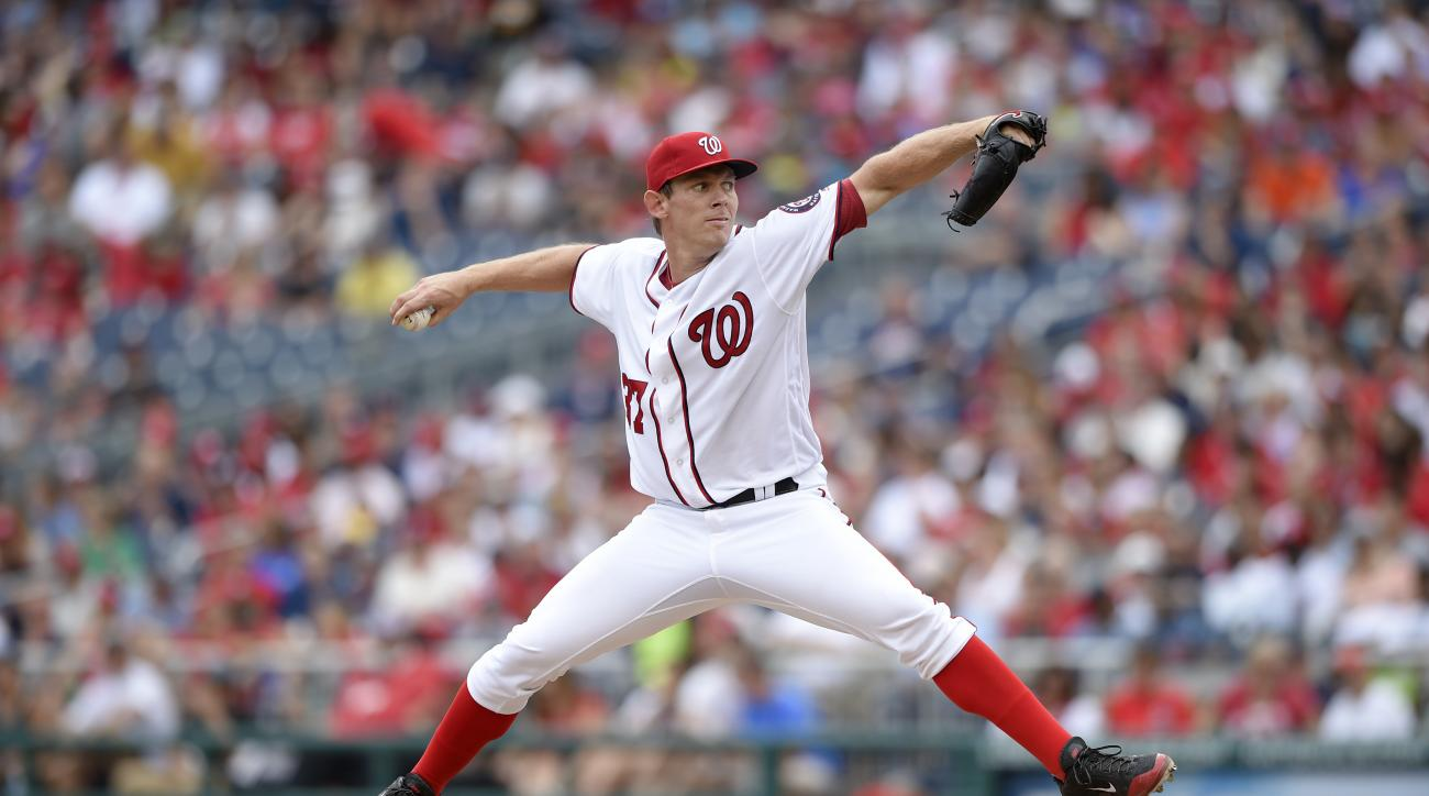 FILE - In this July 3, 2016, file photo, Washington Nationals starting pitcher Stephen Strasburg delivers a pitch during a baseball game against the Cincinnati Reds, in Washington. (AP Photo/Nick Wass, File)