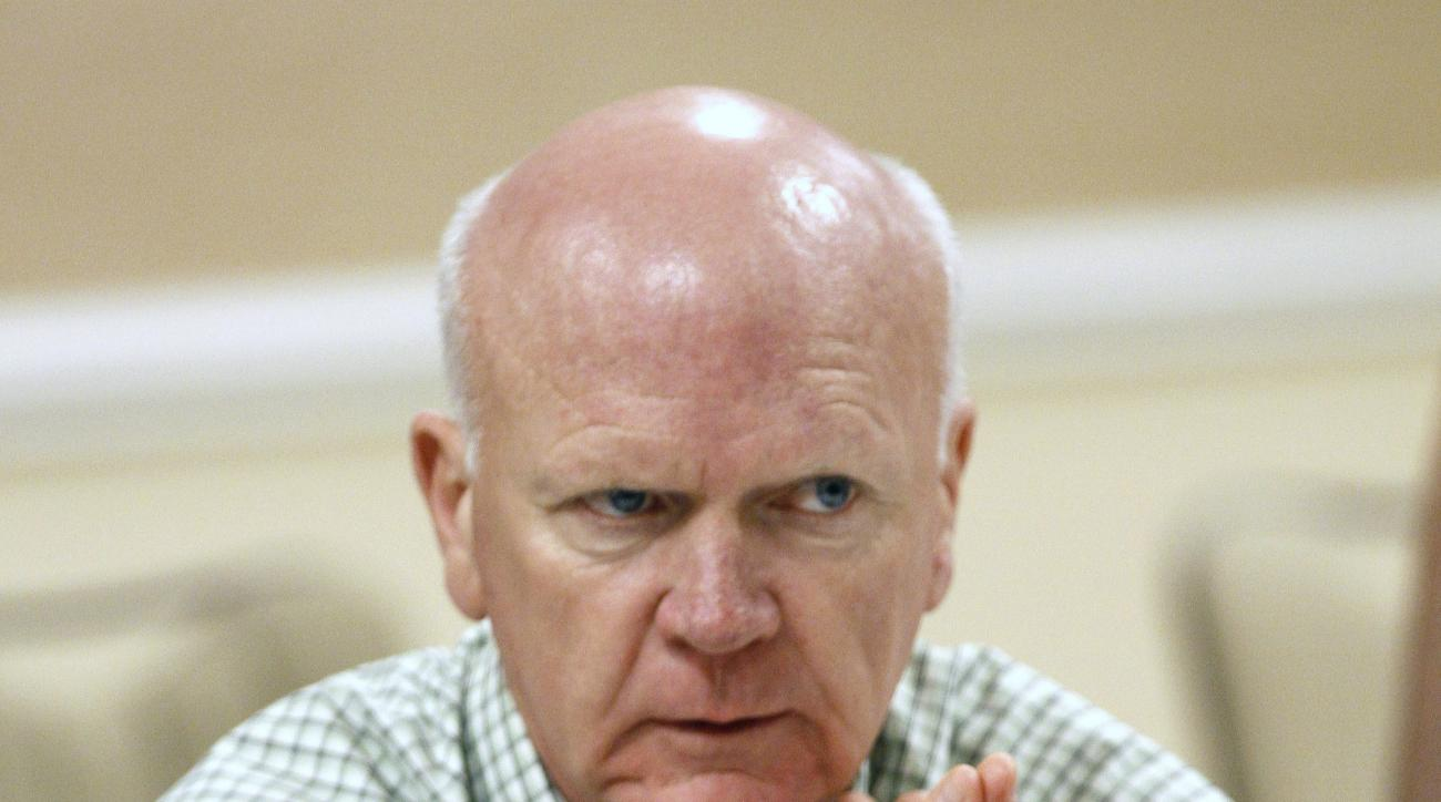 FILE - In this Nov. 12, 2013 file photo, Minnesota Twins general manager Terry Ryan talks with the media at the annual baseball general managers meeting in Orlando, Fla. Ryan has been diagnosed with cancer. He will not be with the team for the start of sp