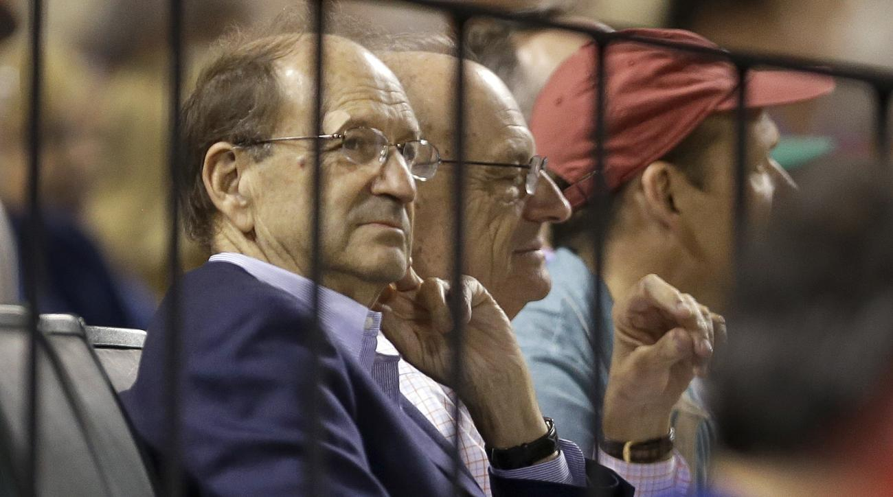 FILE - In this June 26, 2015, file photo, St. Louis Cardinals owner Bill DeWitt Jr. watches during the eighth inning of a baseball game between the Cardinals and the Chicago Cubs in St. Louis. The former scouting director of the St. Louis Cardinals has pl