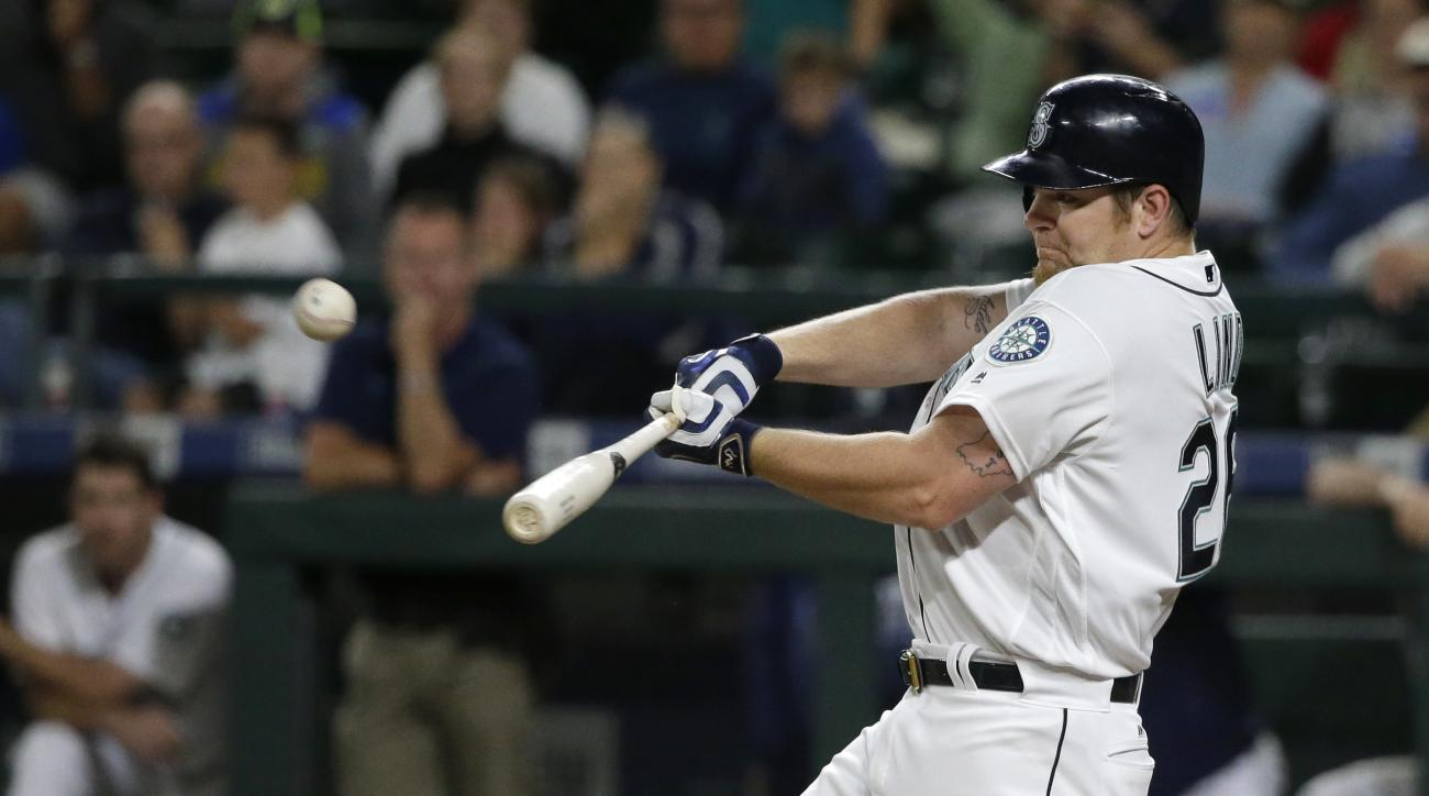 Seattle Mariners' Adam Lind hits a three-run walk-off home run in the ninth inning of a baseball game against the Chicago White Sox, Monday, July 18, 2016, in Seattle. The Mariners beat the White Sox 4-3. (AP Photo/Ted S. Warren)