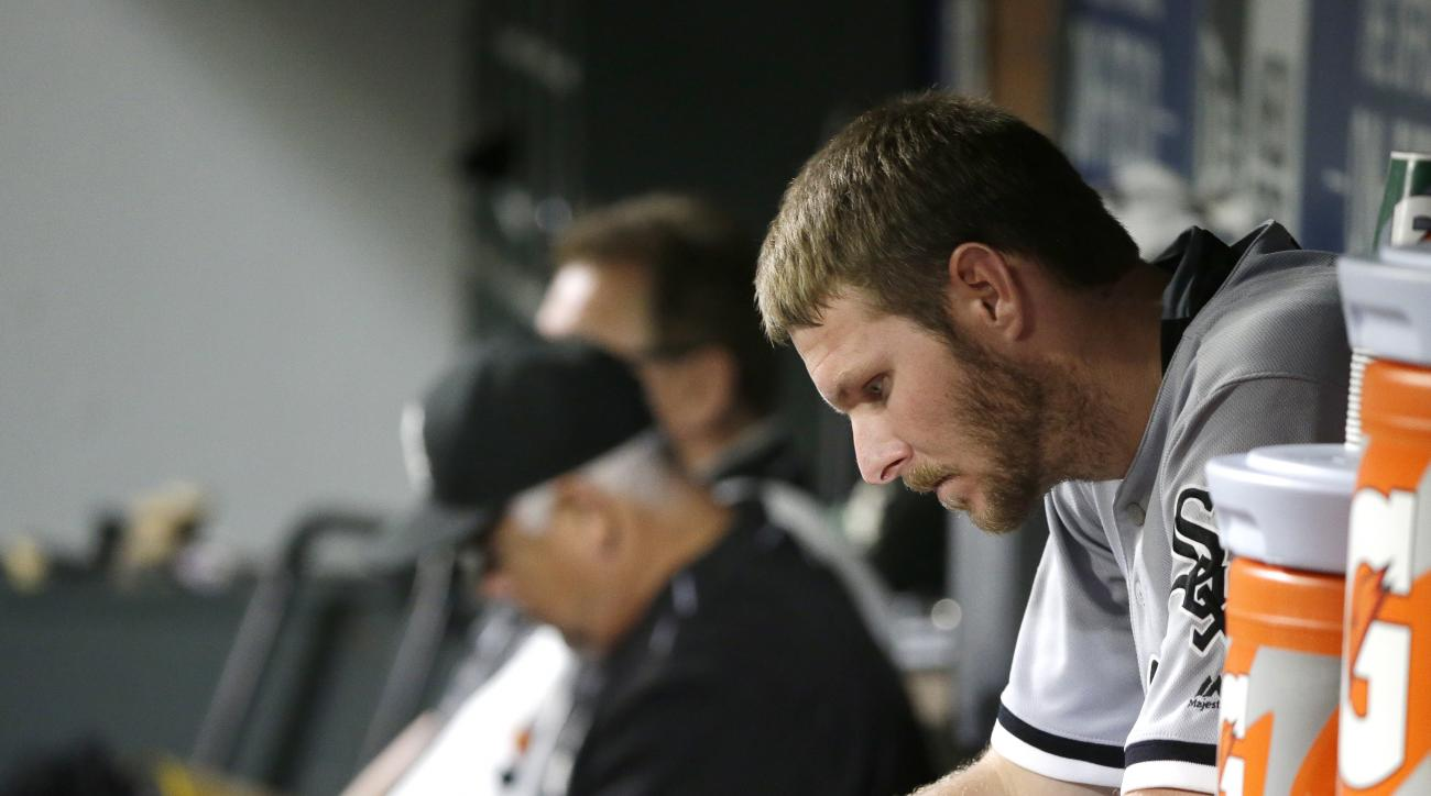 Chicago White Sox pitcher Chris Sale sits in the dugout after he threw eight shutout innings against the Seattle Mariners, giving up one hit, in a baseball game, Monday, July 18, 2016, in Seattle. White Sox' David Robertson blew the save in the ninth inni