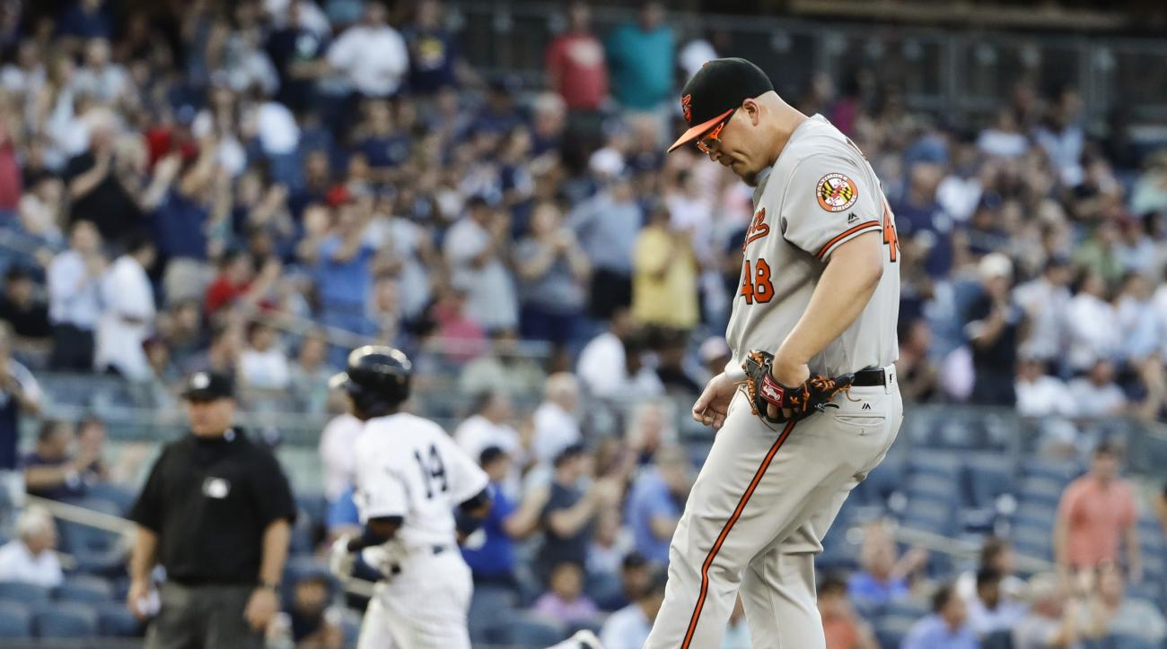 Baltimore Orioles relief pitcher Vance Worley reacts as New York Yankees' Starlin Castro runs the bases after hitting a two run home run during the second inning of a baseball game Tuesday, July 19, 2016, in New York. (AP Photo/Frank Franklin II)