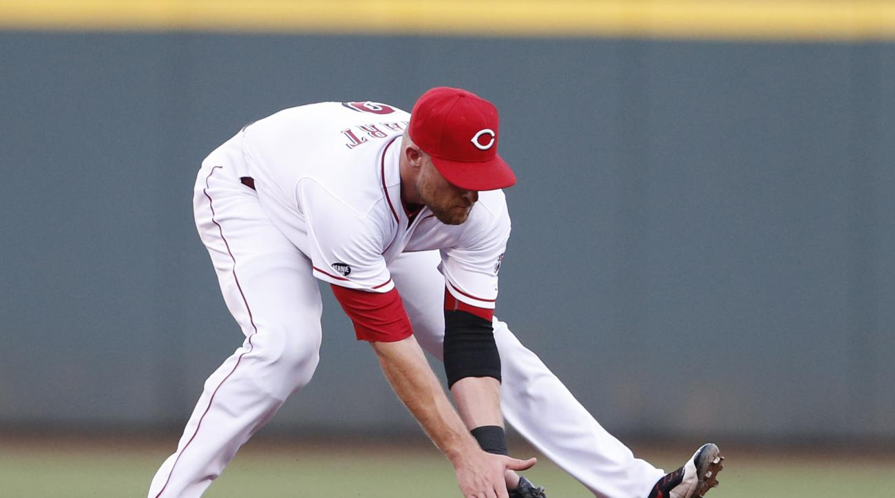 Cincinnati Reds shortstop Zack Cozart fields a ground ball off the bat of Atlanta Braves' Adonis Garcia during the third inning of a baseball game, Tuesday, July 19, 2016, in Cincinnati. (AP Photo/Gary Landers)