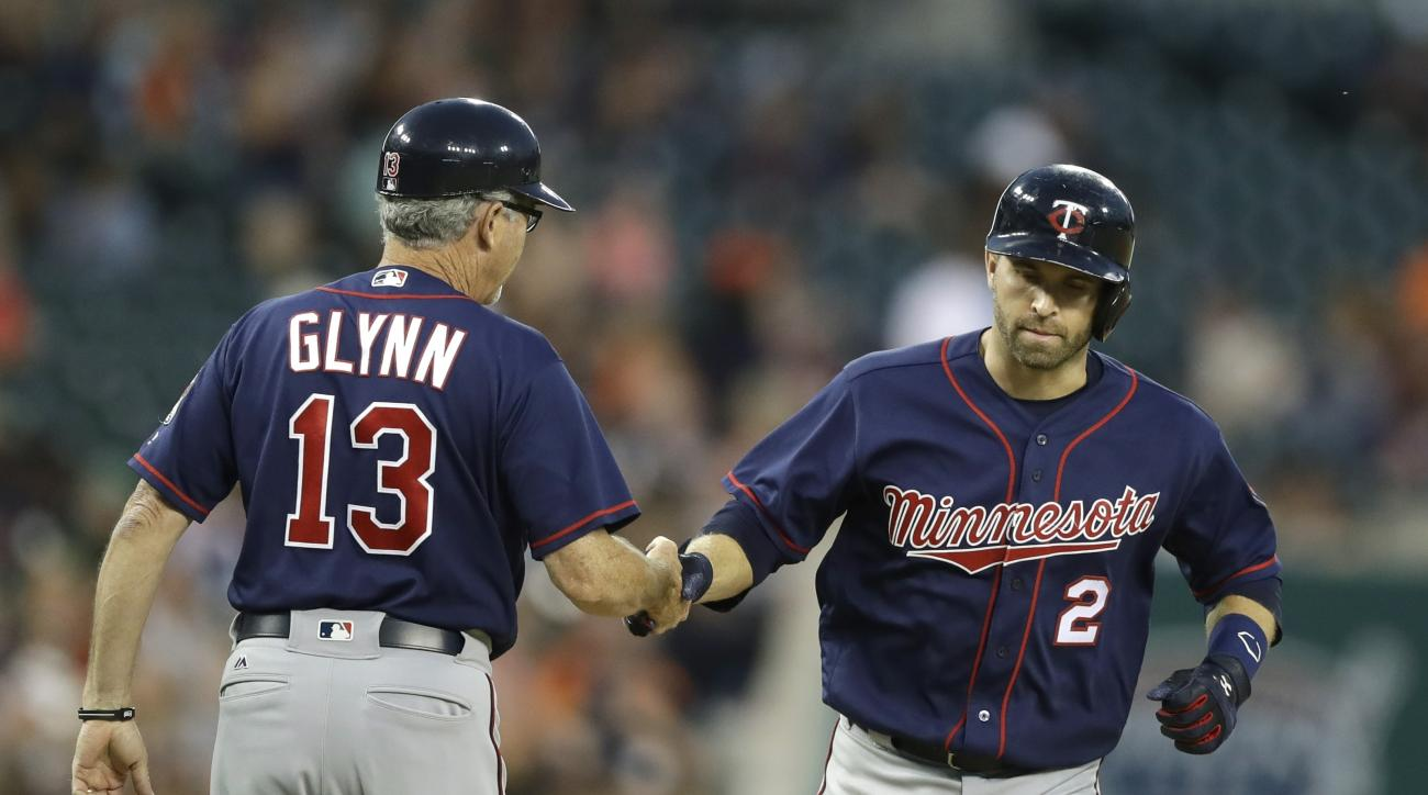 Minnesota Twins' Brian Dozier is congratulated by third base coach Gene Glynn after a two-run home run during the seventh inning of a baseball game against the Detroit Tigers, Tuesday, July 19, 2016 in Detroit. (AP Photo/Carlos Osorio)