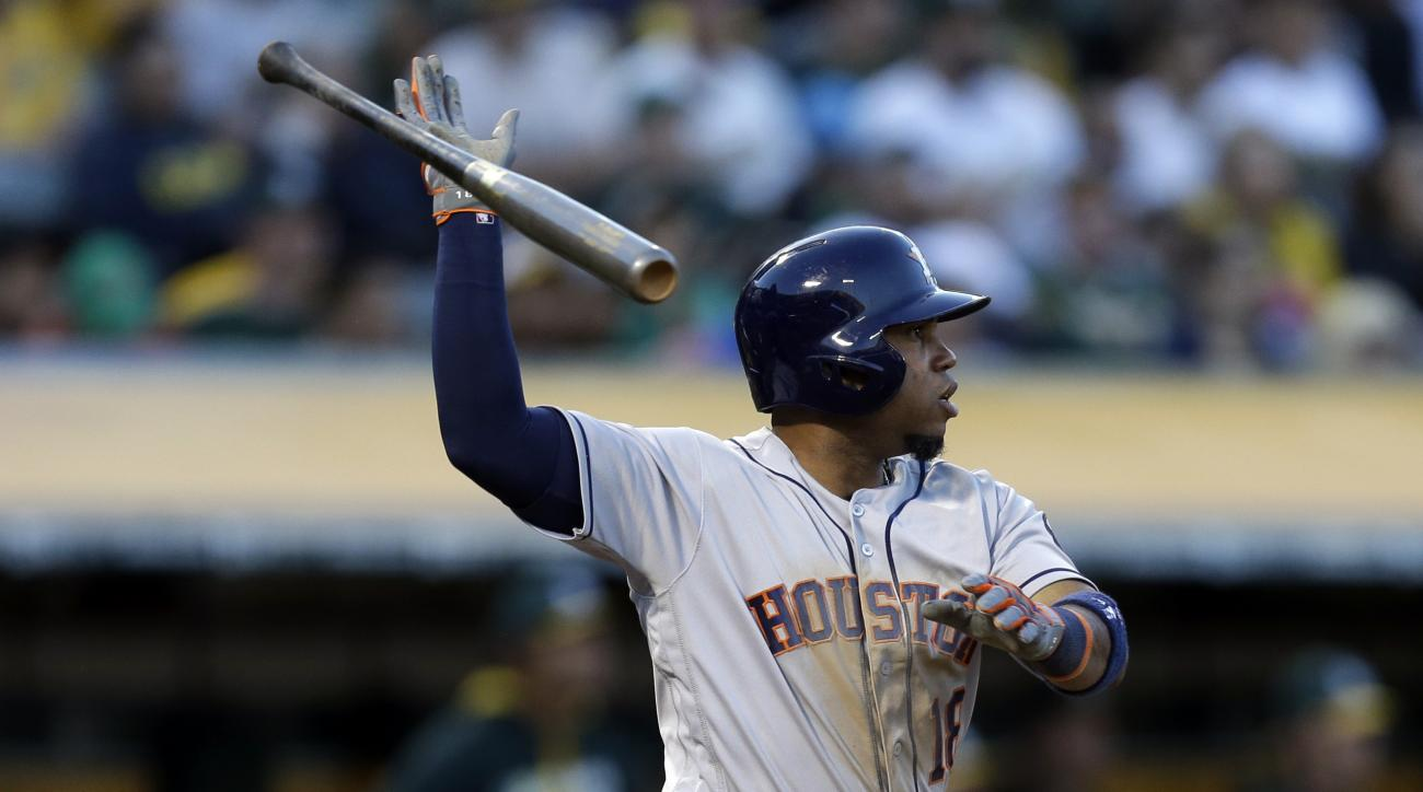 Houston Astros' Luis Valbuena tosses his bat after hitting an RBI single off Oakland Athletics' Dillon Overton in the third inning of a baseball game Tuesday, July 19, 2016, in Oakland, Calif. (AP Photo/Ben Margot)