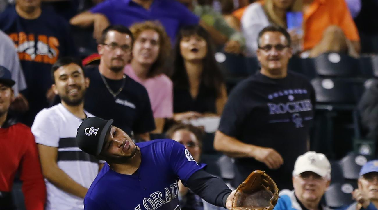 Colorado Rockies third baseman Nolan Arenado misses a foul ball hit by Tampa Bay Rays' Kevin Kiermaier during the third inning of a baseball game, Tuesday, July 19, 2016, in Denver. (AP Photo/Jack Dempsey)