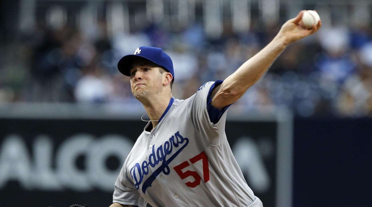 FILE - In this May 21, 2016, file photo, Los Angeles Dodgers starting pitcher Alex Wood throws against the San Diego Padres during the first inning of a baseball game in San Diego. Wood is set to undergo arthroscopic surgery on his left elbow that will ke