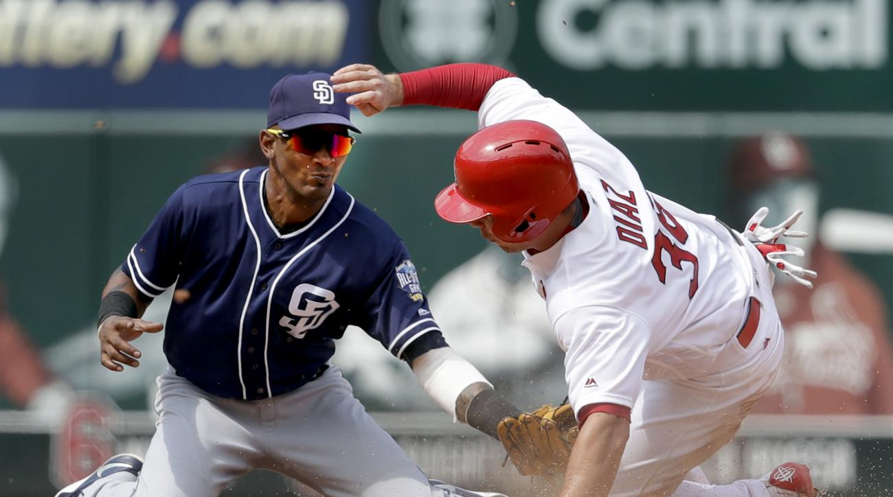St. Louis Cardinals' Aledmys Diaz, right, is tagged out by San Diego Padres shortstop Alexei Ramirez while trying to steal second during the seventh inning in the first game of a baseball doubleheader Wednesday, July 20, 2016, in St. Louis. (AP Photo/Jeff