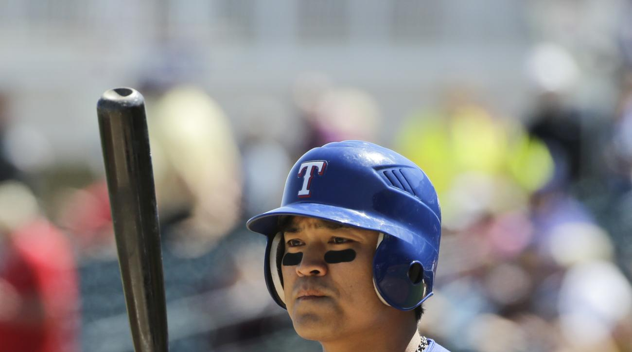 FILE - In this Wednesday, March 30, 2016 photo Texas Rangers' Shin-Soo Choo, of South Korea, waits for his turn at bat during a spring training baseball game against the Kansas City Royals in Surprise, Ariz. Prince Fielder and outfielder Shin-Soo Choo wer