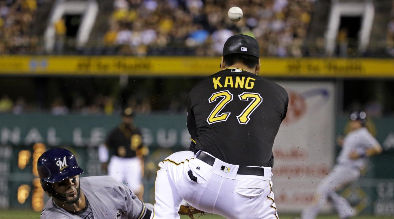 Pittsburgh Pirates third baseman Jung Ho Kang (27) can't handle the throw from catcher Francisco Cervelli as Milwaukee Brewers' Jonathan Villar, left, steals third in the sixth inning of a baseball game in Pittsburgh, Wednesday, July 20, 2016. (AP Photo/G