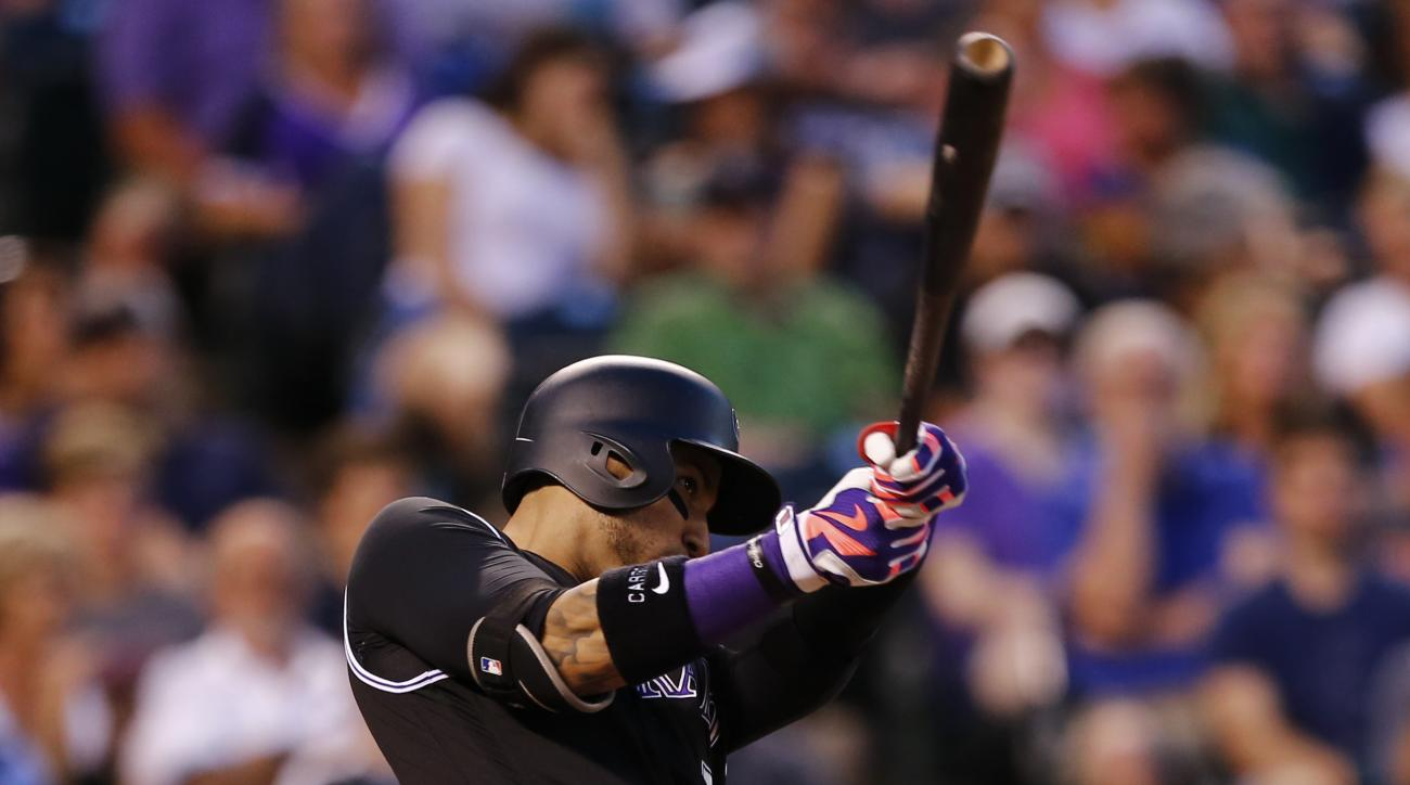 Colorado Rockies' Carlos Gonzalez hits a three run home run off Atlanta Braves starting pitcher Mike Foltynewicz during the sixth inning of a baseball game, Thursday, July 21, 2016, in Denver. (AP Photo/Jack Dempsey)