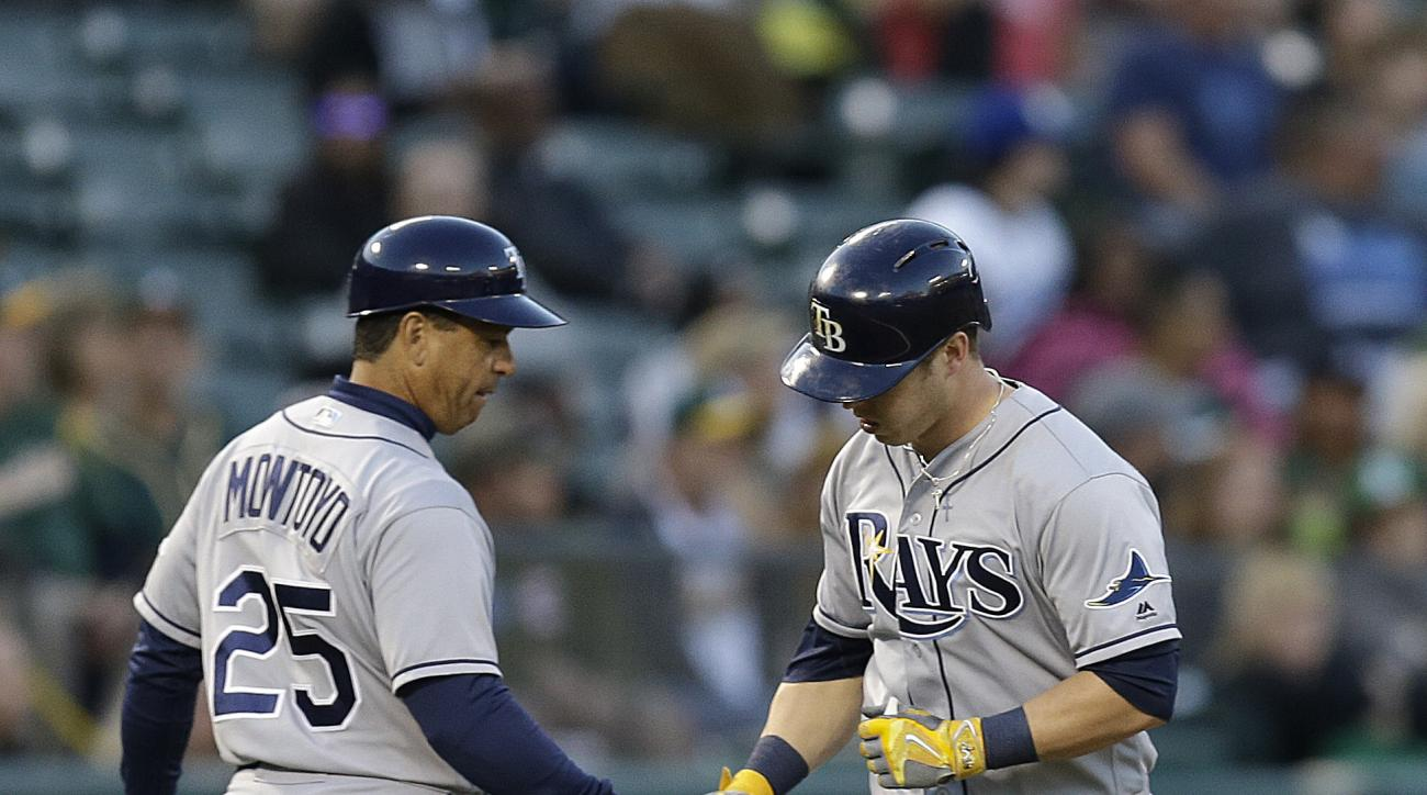 Tampa Bay Rays' Corey Dickerson, right, is congratulated by third base coach Charlie Montoyo (25) after hitting a home run off Oakland Athletics' Sonny Gray in the fourth inning of a baseball game Thursday, July 21, 2016, in Oakland, Calif. (AP Photo/Ben