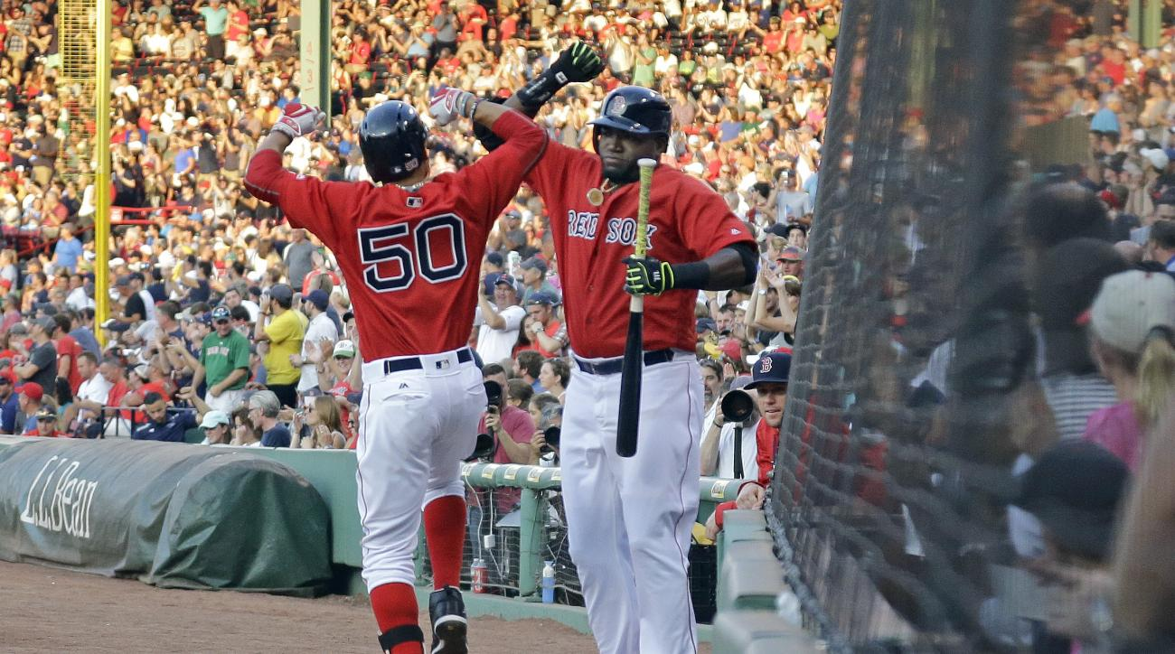 Boston Red Sox designated hitter David Ortiz celebrates with teammate Mookie Betts (50) after Betts hit a solo home run during the first inning of a baseball game against the Minnesota Twins at Fenway Park, Friday, July 22, 2016, in Boston. (AP Photo/Elis