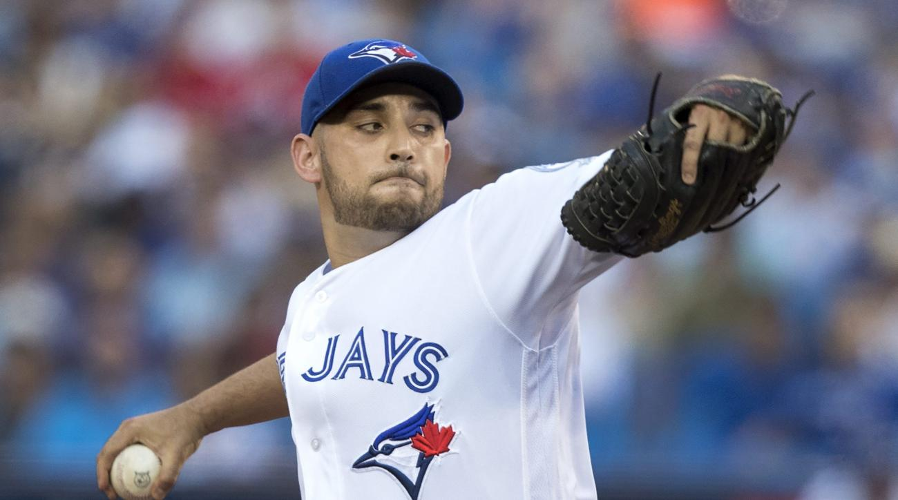 Toronto Blue Jays starting pitcher Marco Estrada throws against the Seattle Mariners during the first inning of a baseball game in Toronto, Friday, July 22, 2016. (Fred Thornhill/The Canadian Press via AP)