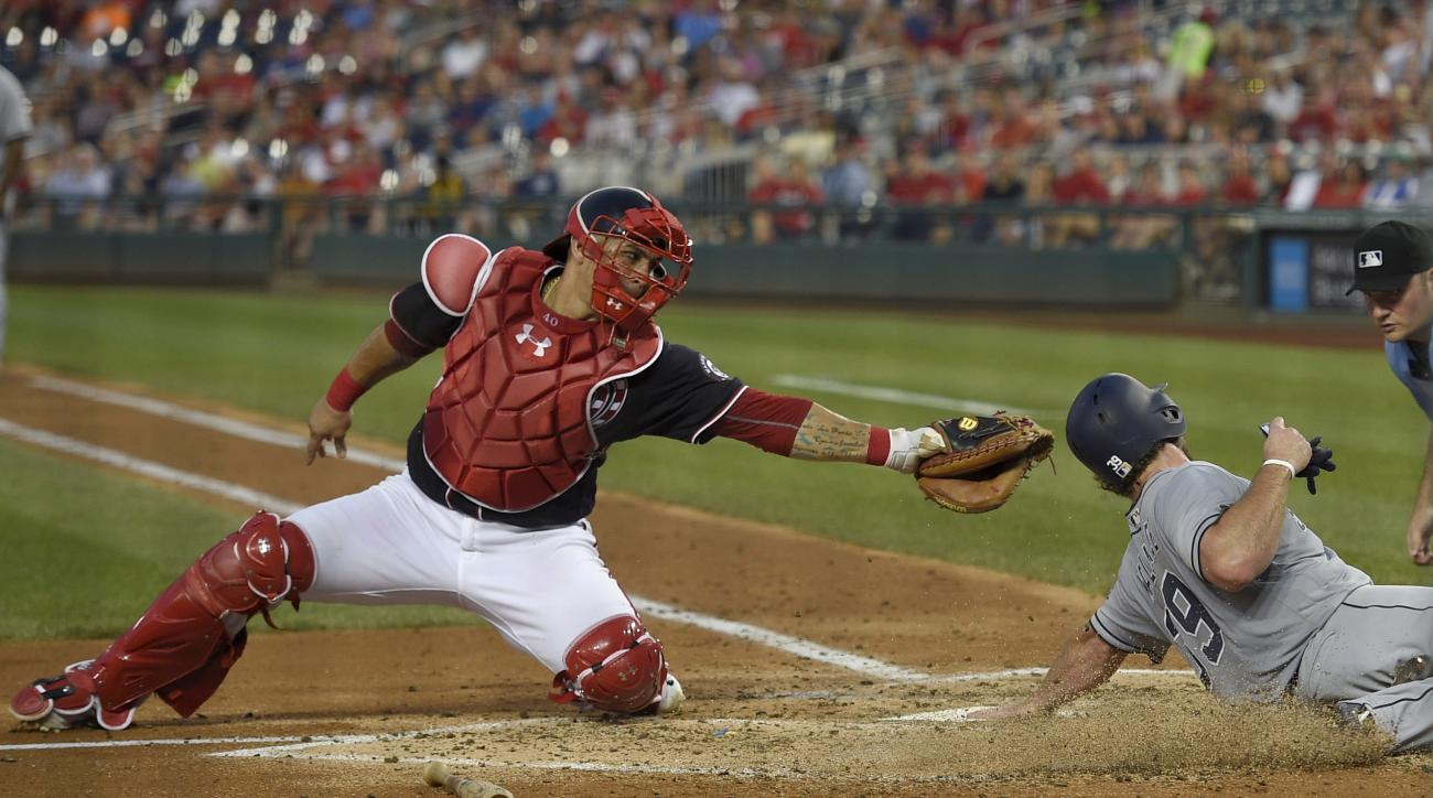 San Diego Padres' Brett Wallace, front right, is safe at home as he slides past Washington Nationals catcher Wilson Ramos (40), left, to score on a single by Melvin Upton Jr. during the fifth inning of a baseball game, Friday, July 22, 2016, in Washington