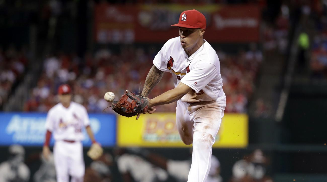 St. Louis Cardinals second baseman Kolten Wong uses his glove to a toss a ball to first baseman Matt Adams forcing out Los Angeles Dodgers' Chase Utley at first to end the top of the fourth inning of a baseball game Friday, July 22, 2016, in St. Louis. (A