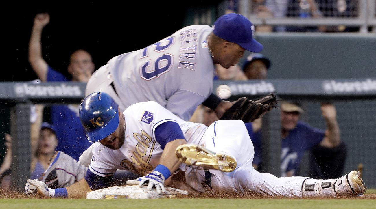 Kansas City Royals' Alex Gordon beats the tag at third by Texas Rangers third baseman Adrian Beltre (29) after hitting a triple during the fourth inning of a baseball game Friday, July 22, 2016, in Kansas City, Mo. (AP Photo/Charlie Riedel)