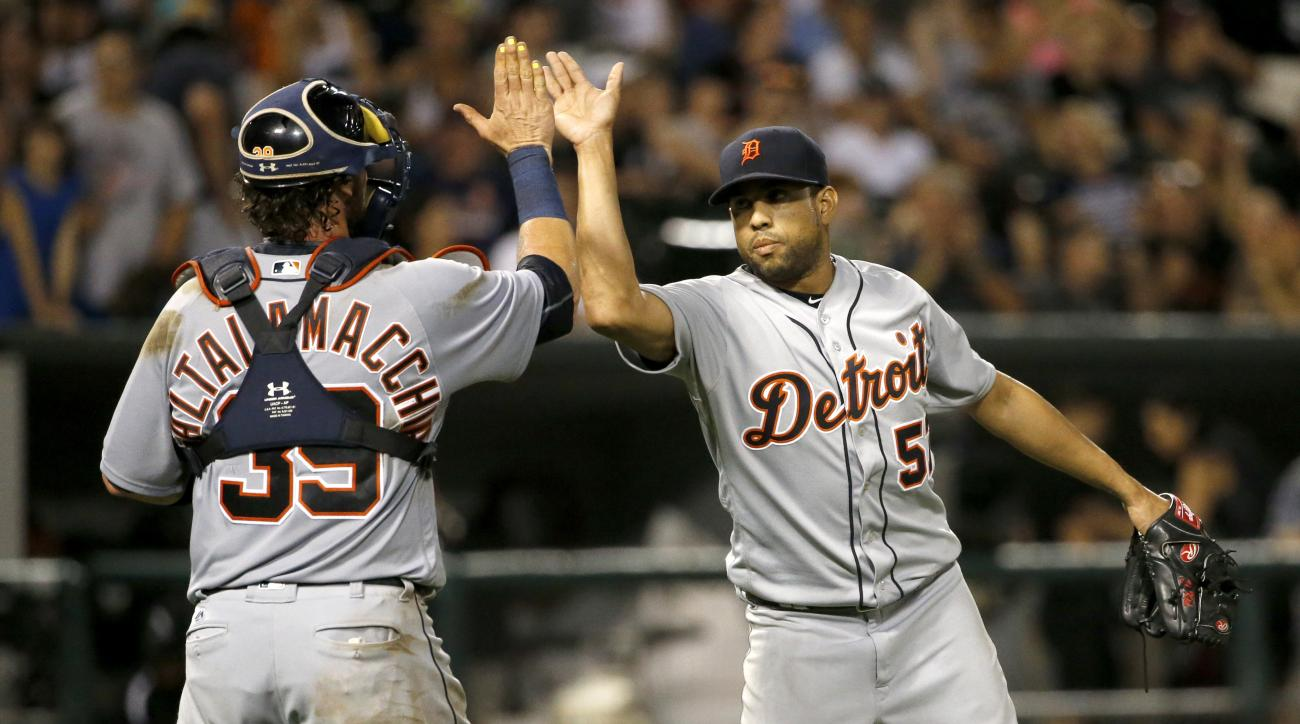 Detroit Tigers catcher Jarrod Saltalamacchia, left, and relief pitcher Francisco Rodriguez celebrate the Tigers' 7-5 win over the Chicago White Sox in a baseball game Friday, July 22, 2016, in Chicago. (AP Photo/Charles Rex Arbogast)