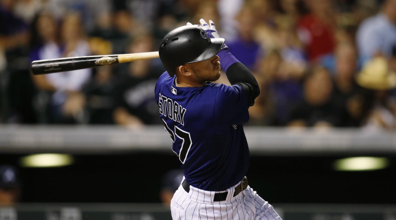 Colorado Rockies' Trevor Story watches his two-run home run off Atlanta Braves relief pitcher Dario Alvarez in the sixth inning of a baseball game Friday, July 22, 2016 in Denver. The Rockies won 4-3. (AP Photo/David Zalubowski)