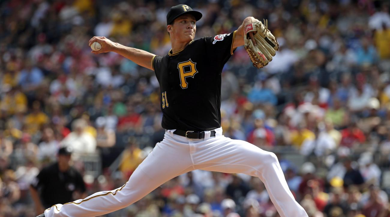 Pittsburgh Pirates starting pitcher Tyler Glasnow delivers in the first inning of a baseball game against the Philadelphia Phillies in Pittsburgh, Saturday, July 23, 2016. (AP Photo/Gene J. Puskar)