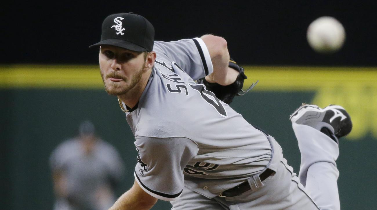 FILE - In this Monday, July 18, 2016, file photo, Chicago White Sox starting pitcher Chris Sale throws to a Seattle Mariners batter during a baseball game in Seattle. Sale has been scratched from his start against the Detroit Tigers after he was involved
