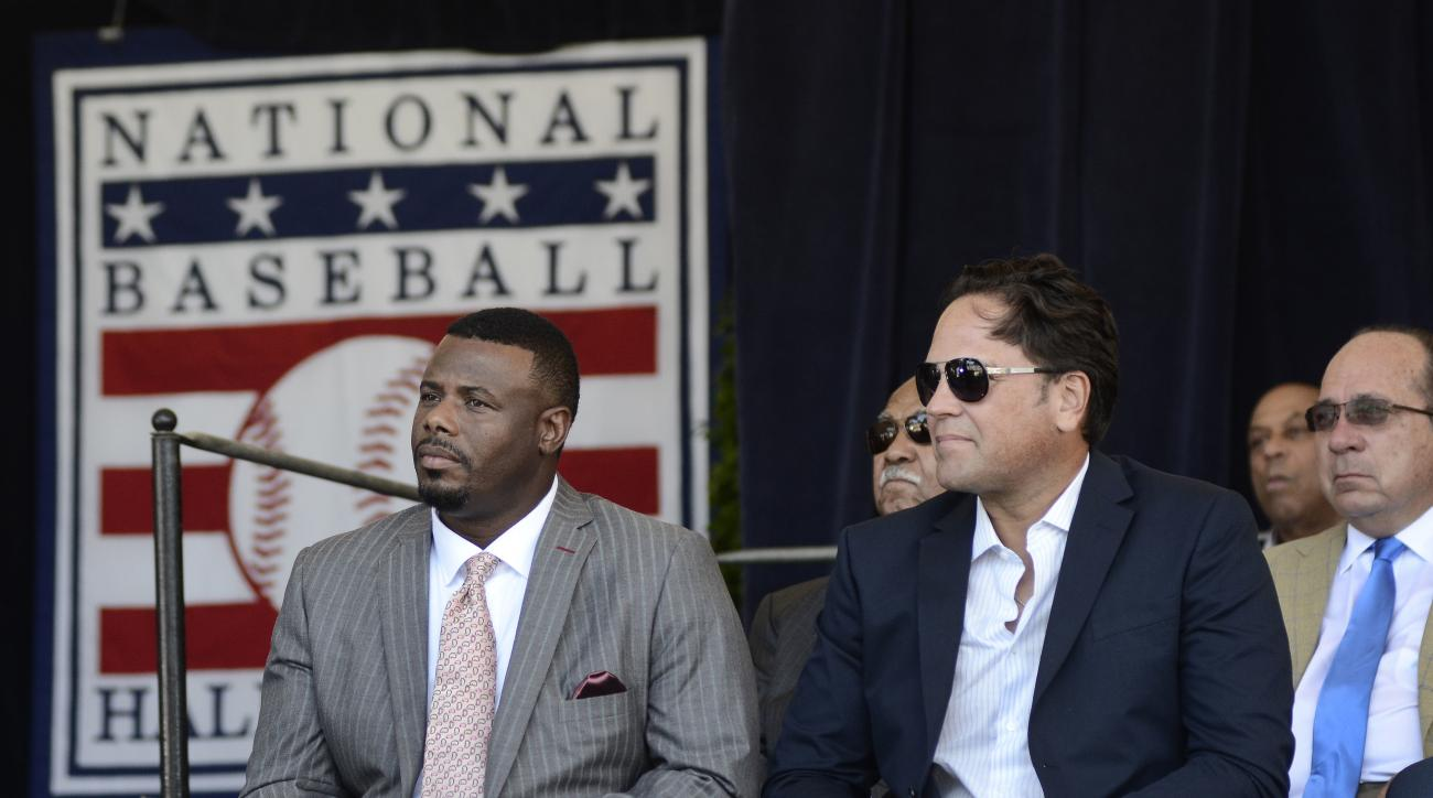 Ken Griffey Jr., left, and Mike Piazza listen during an awards ceremony at Doubleday Field on Saturday, July 23, 2016, in Cooperstown, N.Y. The two are to be inducted Sunday. (AP Photo/Heather Ainsworth)