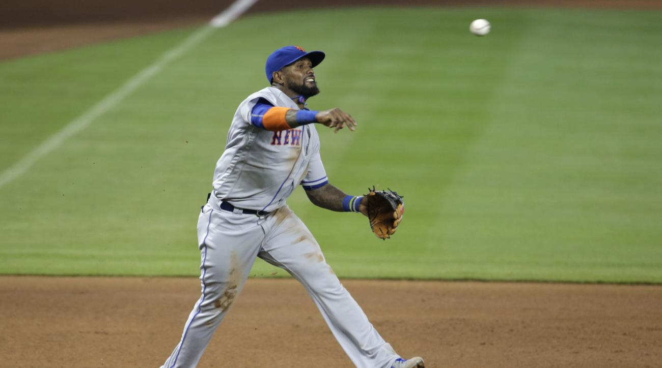 New York Mets third baseman Jose Reyes throws to first where Miami Marlins' J.T. Realmuto was out during the fourth inning of a baseball game, Sunday, July 24, 2016, in Miami. (AP Photo/Lynne Sladky)