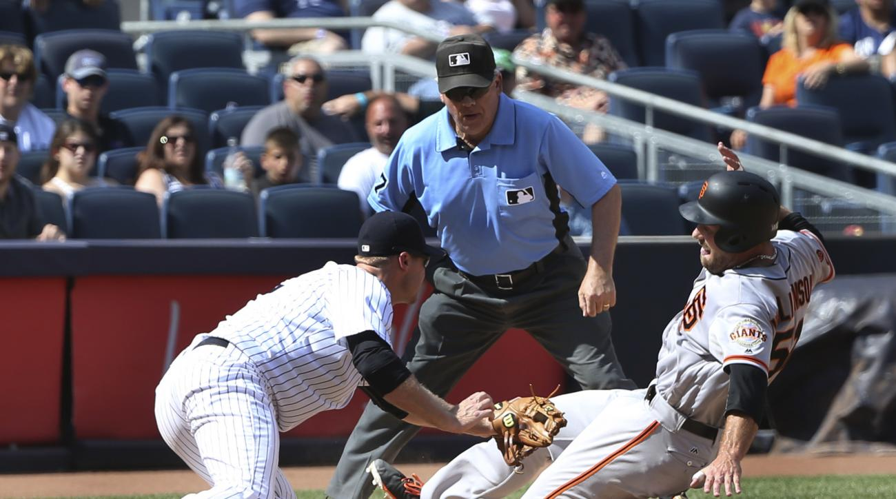 New York Yankees third baseman Chase Headley, left, completes a double play by tagging out San Francisco Giants' Mac Williamson at third base during the eighth inning of the baseball game at Yankee Stadium, Sunday, July 24, 2016 in New York. (AP Photo/Set