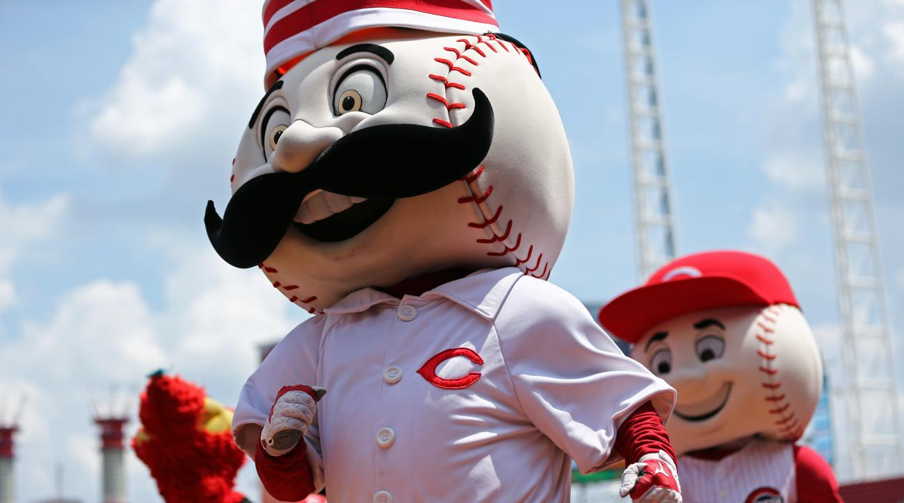 Cincinnati Reds mascots race around the field between innings of a baseball game between the Arizona Diamondbacks and the Reds, Sunday, July 24, 2016, in Cincinnati. The Diamondbacks won 9-8. (AP Photo/Aaron Doster)