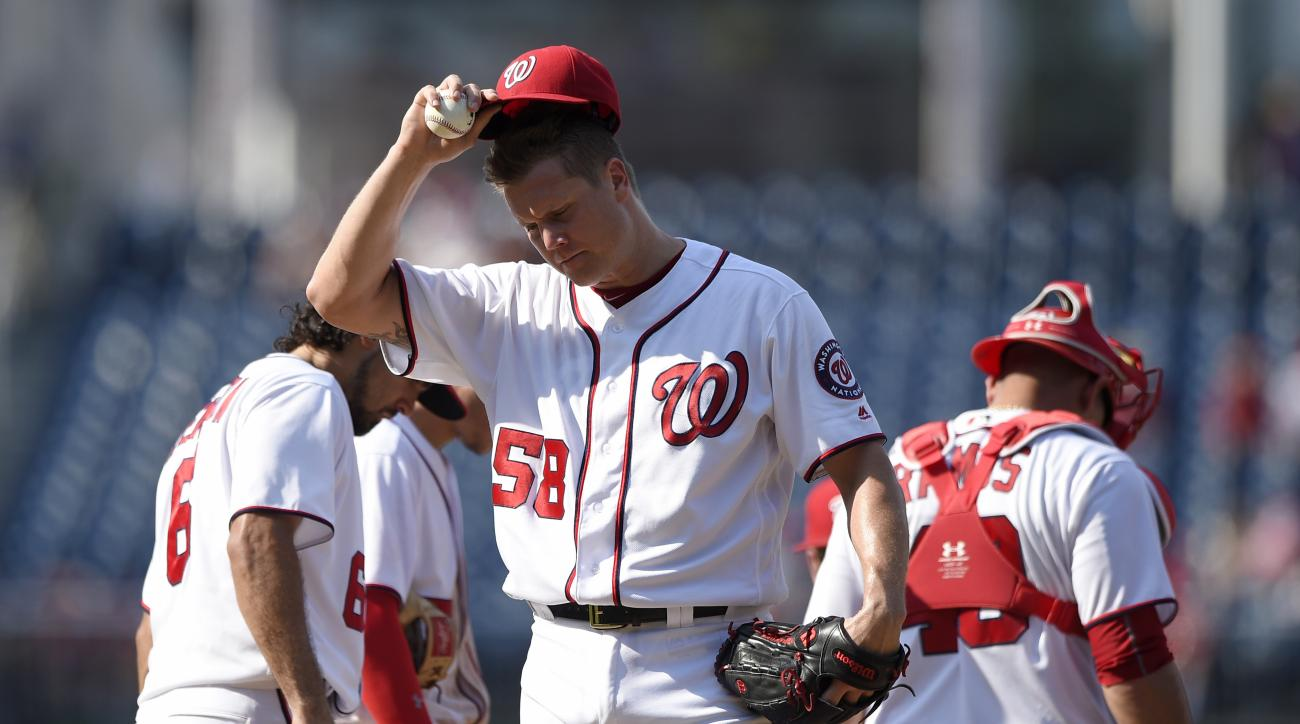 Washington Nationals relief pitcher Jonathan Papelbon (58) reacts near the mound as he is about to be pulled from the baseball game during the ninth inning against the San Diego Padres, Sunday, July 24, 2016, in Washington. Papelbon gave up four runs in t