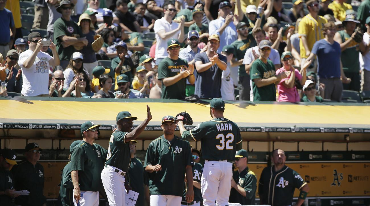 Oakland Athletics starting pitcher Jesse Hahn is greeted in the dugout after being removed in the eighth inning of a baseball game against the Tampa Bay Rays, Sunday, July 24, 2016, in Oakland, Calif. (AP Photo/Eric Risberg)