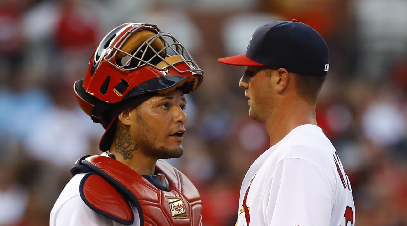 St. Louis Cardinals starting pitcher Mike Mayers, right, talks with catcher Yadier Molina after allowing a grand slam to Los Angeles Dodgers' Adrian Gonzalez during the first inning of a baseball game Sunday, July 24, 2016, in St. Louis. (AP Photo/Billy H