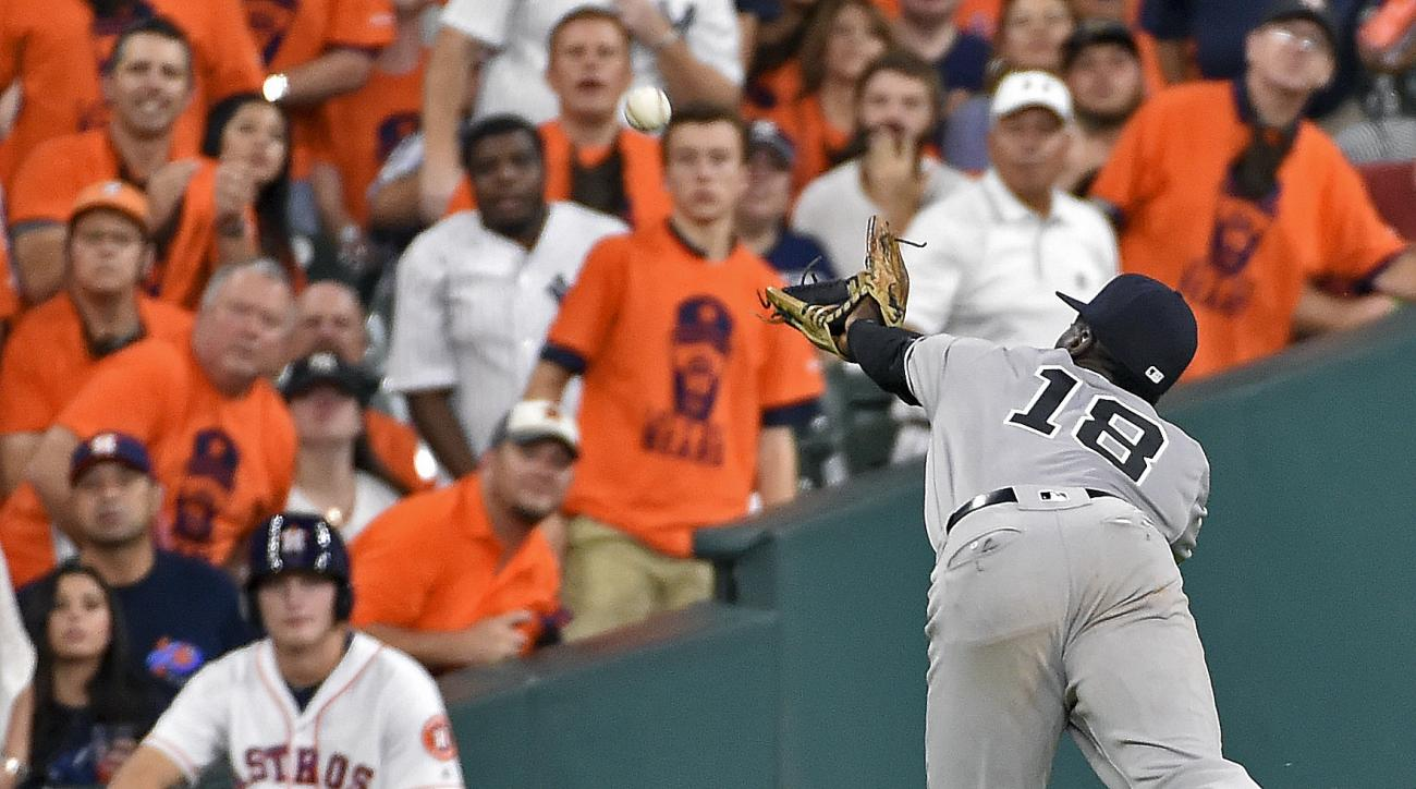 New York Yankees shortstop Didi Gregorius (18) can't catch the shallow fly ball of Houston Astros' Luis Valbuena in the ninth inning of a baseball game, Monday, July 25, 2016, in Houston. (AP Photo/Eric Christian Smith)