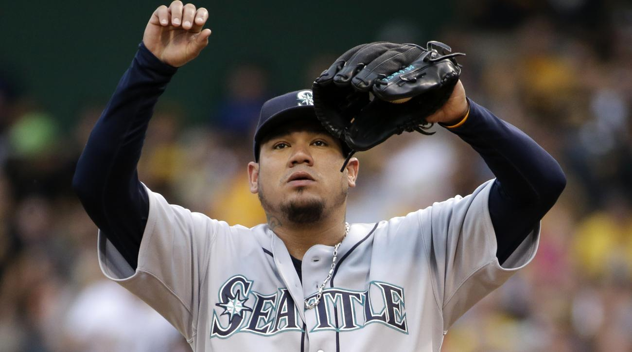 Seattle Mariners starting pitcher Felix Hernandez collects himself on the mound after giving up a solo home run to Pittsburgh Pirates' Gregory Polanco during the first inning of a baseball game in Pittsburgh, Tuesday, July 26, 2016. (AP Photo/Gene J. Pusk