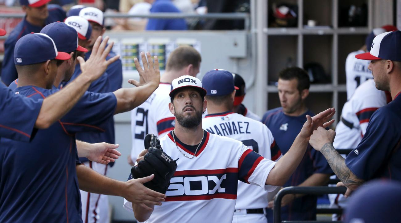 Chicago White Sox starting pitcher James Shields is greeted in the dugout after pitching out of a bases-loaded jam during the second inning of a baseball game against the Chicago Cubs on Tuesday, July 26, 2016, in Chicago. (AP Photo/Charles Rex Arbogast)