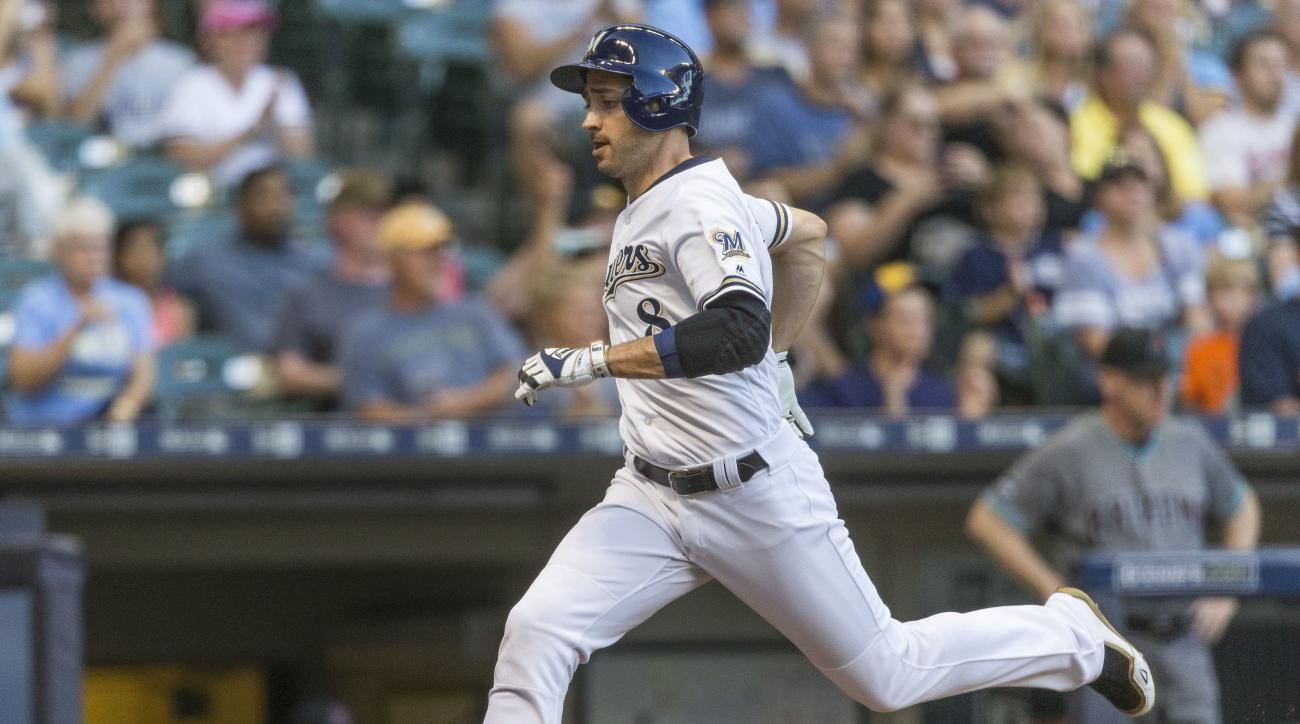 Milwaukee Brewers' Ryan Braun races home to score against the Arizona Diamondbacks during the first inning of a baseball game Tuesday, July 26, 2016, in Milwaukee. (AP Photo/Tom Lynn)