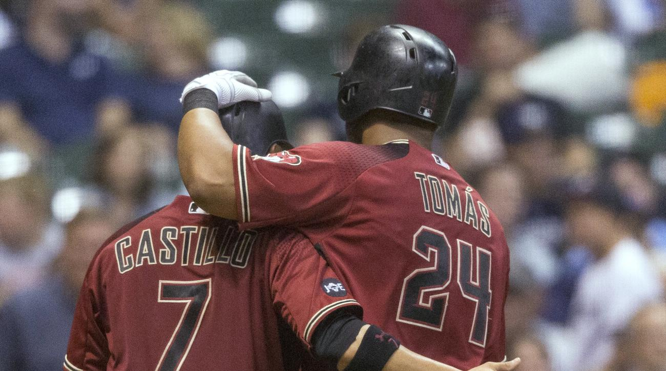 Arizona Diamondbacks' Yasmany Tomas is greeted by Welington Castillo after hitting a two-run home run, his second homer of the baseball game, off Milwaukee Brewers' Jimmy Nelson during the fifth inning Wednesday, July 27, 2016, in Milwaukee. (AP Photo/Tom