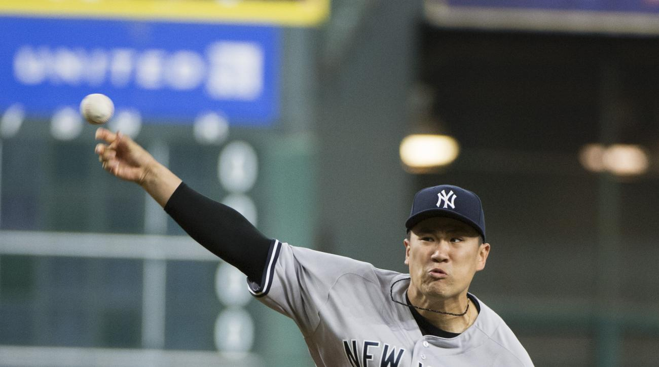 New York Yankees' Masahiro Tanaka pitches against the Houston Astros during the first inning of a baseball game Wednesday, July 27, 2016, in Houston. (AP Photo/George Bridges)