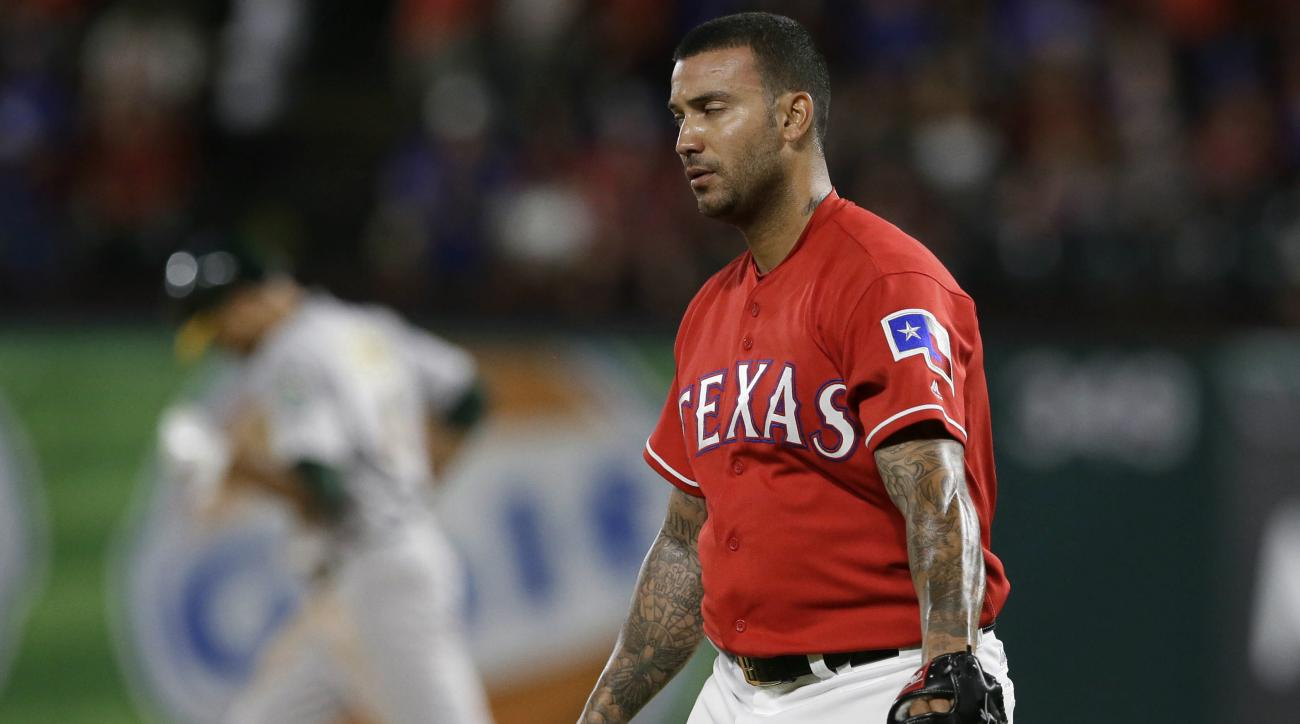 Texas Rangers relief pitcher Matt Bush, right, reacts as Oakland Athletics' Coco Crisp runs the bases on a home run during the eighth inning of a baseball game in Arlington, Texas, Wednesday, July 27, 2016. (AP Photo/LM Otero)