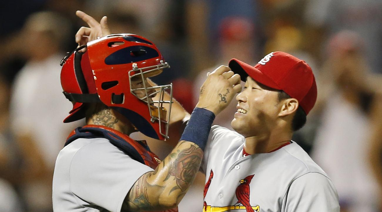 St. Louis Cardinals catcher Yadier Molina and relief pitcher Seung Hwan Oh (26) react after Oh closed out the Cardinals' come-from-behind 5-4 victory over the New York Mets in a baseball game, Wednesday, July 27, 2016, in New York. (AP Photo/Kathy Willens