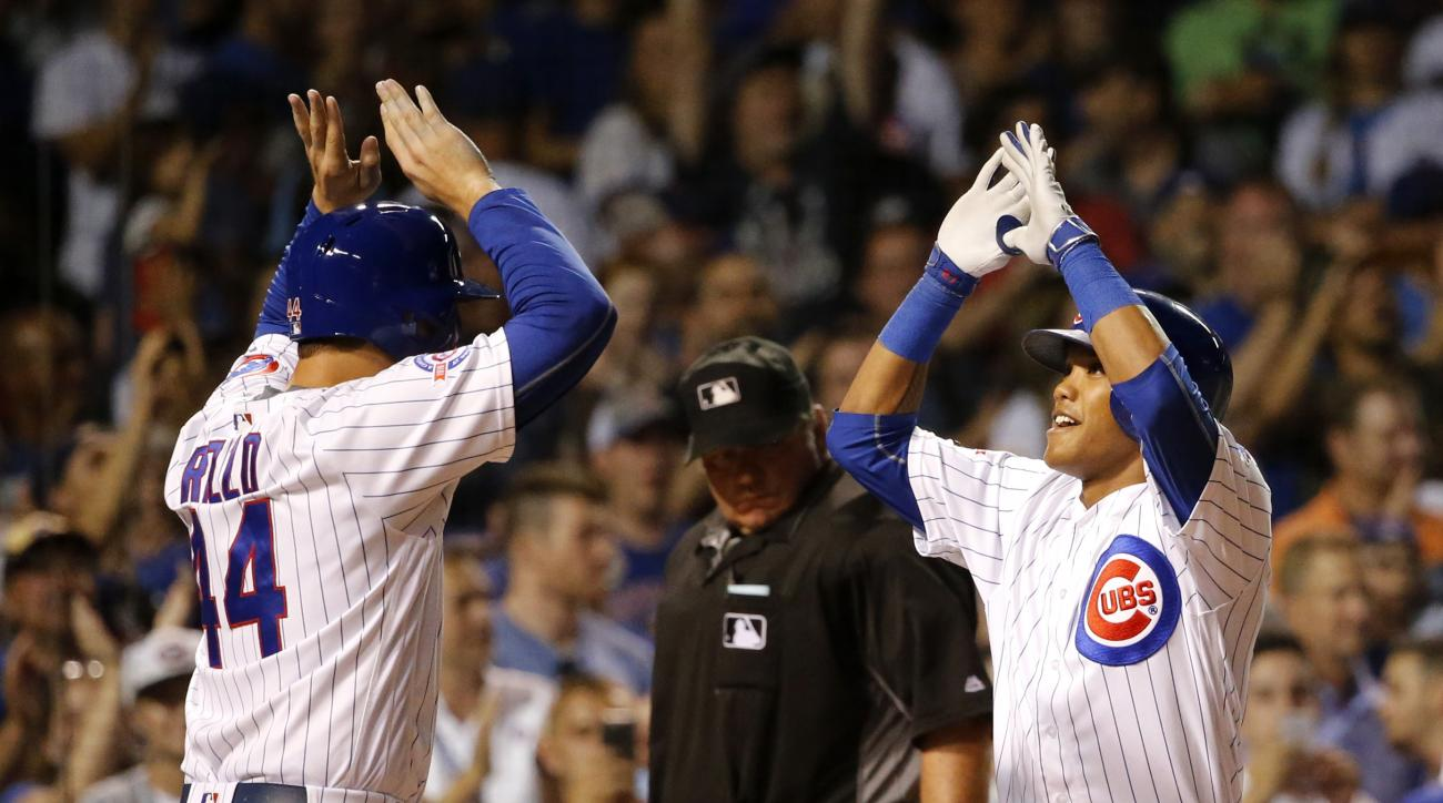 Chicago Cubs' Addison Russell, right, celebrates with Anthony Rizzo after Russell hit a grand slam off Chicago White Sox pitcher Jacob Turner during the eighth inning of a baseball game Wednesday, July 27, 2016, in Chicago. (AP Photo/Charles Rex Arbogast)