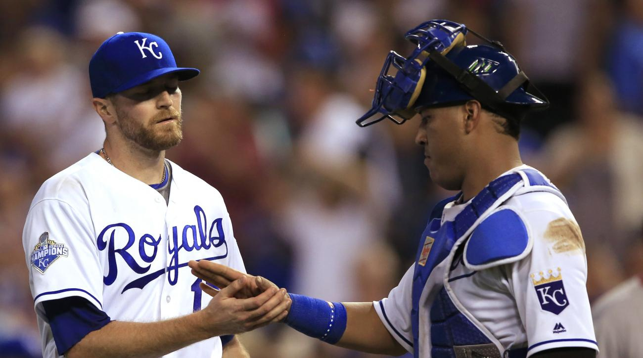 Kansas City Royals relief pitcher Wade Davis (17) is congratulated by catcher Salvador Perez, right, following a baseball game against the Los Angeles Angels at Kauffman Stadium in Kansas City, Mo., Wednesday, July 27, 2016. The Royals defeated the Angels