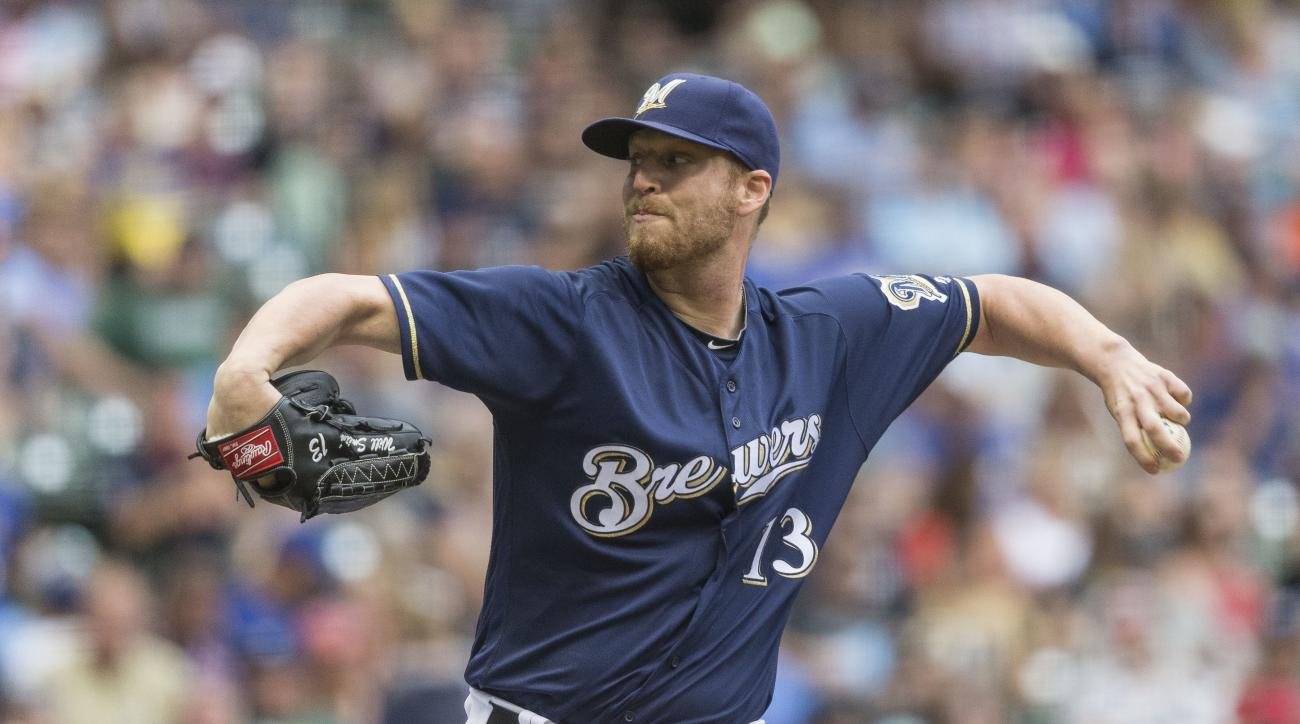 Milwaukee Brewers' Will Smith pitches to a Arizona Diamondbacks' batter during the seventh inning of a baseball game Thursday, July 28, 2016, in Milwaukee. (AP Photo/Tom Lynn)