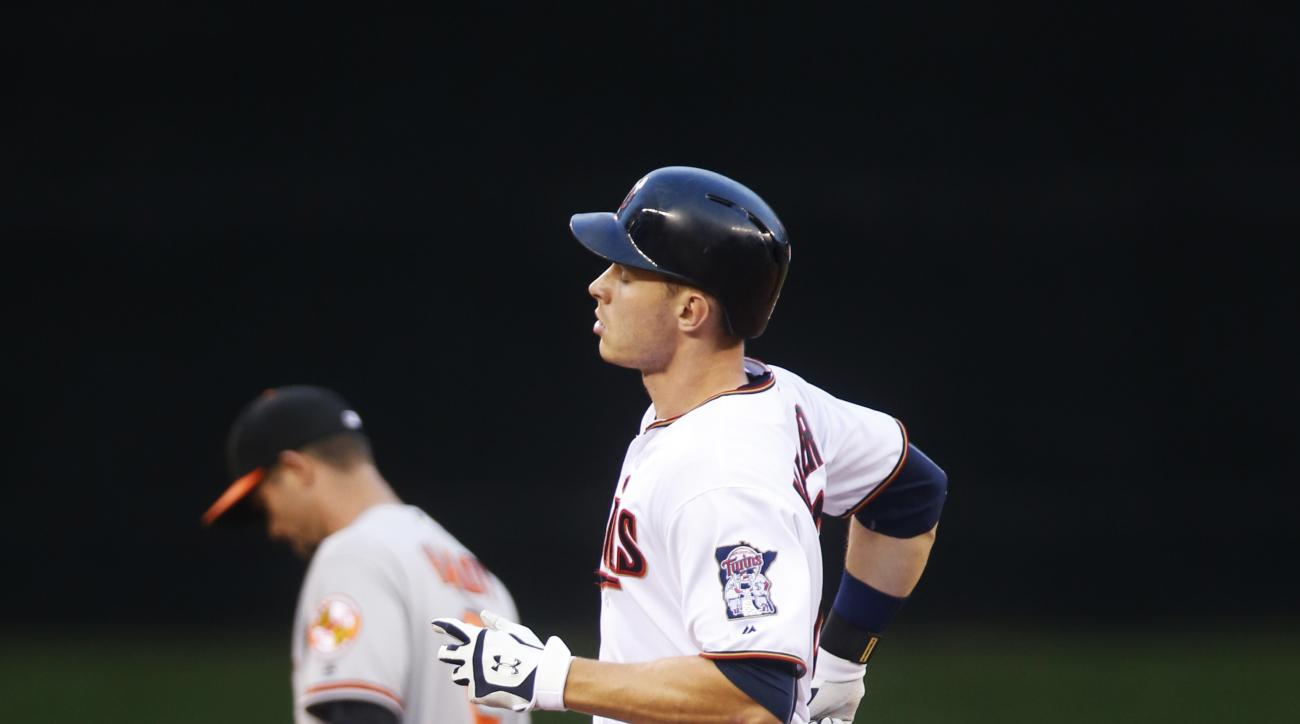 Minnesota Twins' Max Kepler rounds the bases on a solo home run off Baltimore Orioles pitcher Odrisamer Despaigne during the sixth inning of a baseball game Thursday, July 28, 2016, in Minneapolis. (AP Photo/Jim Mone)
