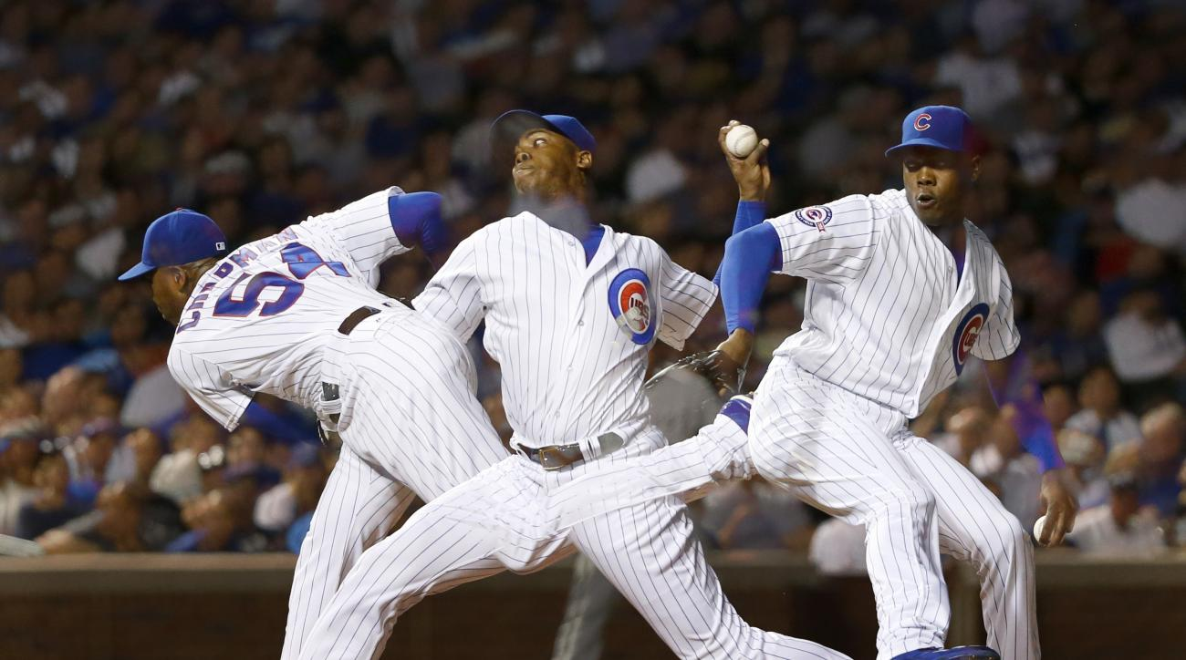 Chicago Cubs relief pitcher Aroldis Chapman delivers in this multiple exposure photo during the ninth inning of a baseball game against the Chicago White Sox on Thursday, July 28, 2016, in Chicago. Chapman recorded his first save as a Cubs beat the Chicag