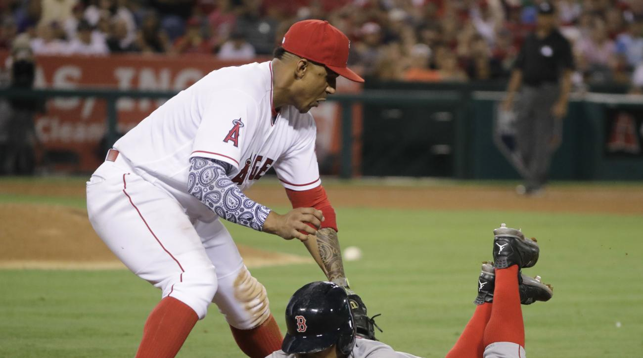 Boston Red Sox's Mookie Betts, bottom, is picked off by Los Angeles Angels first baseman Jefry Marte during the eighth inning of a baseball game, Thursday, July 28, 2016, in Anaheim, Calif. (AP Photo/Jae C. Hong)